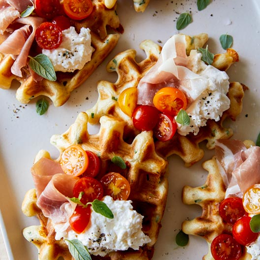 Cheesy Herb Waffle Topped with Burrata, Tomato and Prosciutto